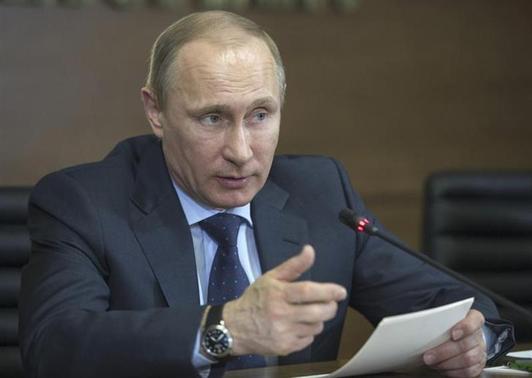 Russian President Vladimir Putin speaks during his visit to a financial crime monitoring centre in Moscow March 4, 2014. REUTERS/Alexei Druzhinin/RIA Novosti/Kremlin