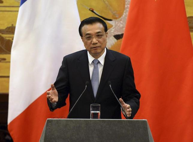 Chinese Premier Li Keqiang gives an address during a news conference with French Prime Minister Jean-Marc Ayrault (not pictured) in the Great Hall of the People in Beijing December 6, 2013 file photo. REUTERS/Mark Ralston/Pool