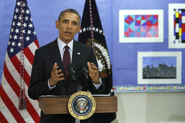 U.S. President Barack Obama answers a question about the situation in Ukraine, following remarks on the budget at Powell Elementary School in Washington March 4, 2014. REUTERS/Jonathan Ernst