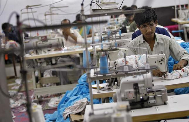 Workers sew clothes at a garment factory in New Delhi May 2, 2013. REUTERS/Anindito Mukherjee/Files