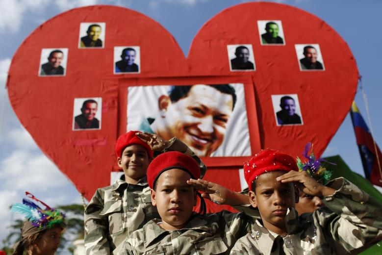 Children dressed as late Venezuelan President Hugo Chavez salute during the Carnival festival in Caracas March 4, 2014. REUTERS/Carlos Garcia Rawlins