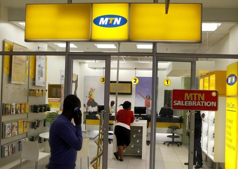 A man speaks on a mobile phone as he walks past a MTN shop at a shopping mall south of Johannesburg June 6, 2012. REUTERS/Siphiwe Sibeko