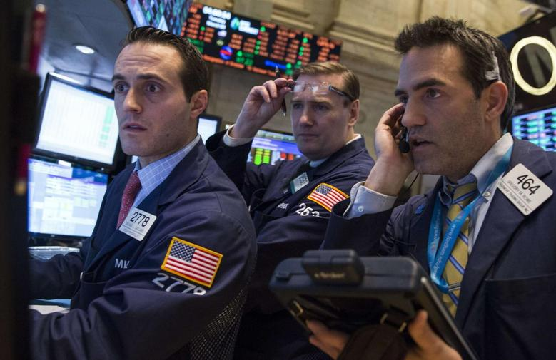 Traders work on the floor of the New York Stock Exchange March 4, 2014. REUTERS/Brendan McDermid