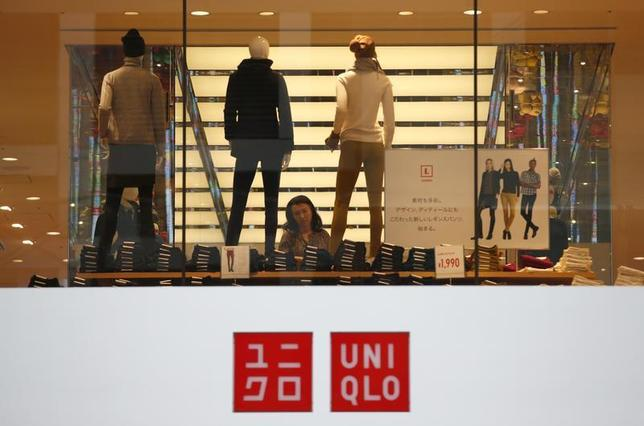 A woman checks clothes at Fast Retailing's Uniqlo casual clothing store in Tokyo October 4, 2013. REUTERS/Issei Kato