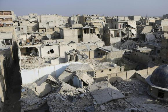 A general view of damage after what activists said was an air strike by forces loyal to Syria's President Bashar al-Assad in the Al-Maysar neighbourhood of Aleppo February 23, 2014. REUTERS/Hosam Katan