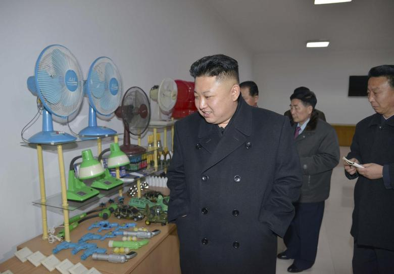 North Korean leader Kim Jong Un (front) walks during a trip to give field guidance to the Pyongyang Weak-current Apparatus Factory, in this undated photo released by North Korea's Korean Central News Agency (KCNA) in Pyongyang on March 3, 2014. REUTERS/KCNA
