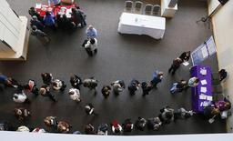Hundreds of job seekers wait in line with their resumes to talk to recruiters (right) at the Colorado Hospital Association health care career fair in Denver April 9, 2013. REUTERS/Rick Wilking