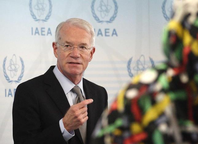 U.S. International Atomic Energy Agency (IAEA) ambassador Joseph Macmanus talks to the media during an IAEA meeting in Vienna June 5, 2013. REUTERS/Heinz-Peter Bader