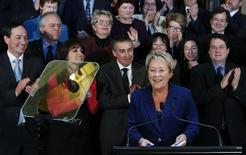 Quebec's Premier Pauline Marois smiles during a news conference before calling an election at the National Assembly in Quebec City, March 5, 2014. REUTERS/Mathieu Belanger