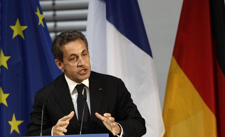 Former French President Nicolas Sarkozy gesture during his speech at an event hosted by the Konrad-Adenauer foundation in Berlin February 28, 2014. REUTERS/Tobias Schwarz