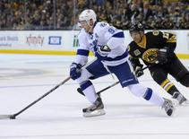 Tampa Bay Lightning center Steven Stamkos (91) skates with the puck while Boston Bruins right wing Jarome Iginla (12) defends during the first period at TD Banknorth Garden. Mandatory Credit: Bob DeChiara-USA TODAY Sports