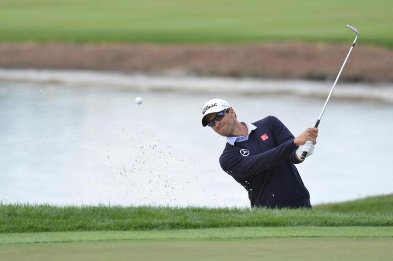Adam Scott hits out of a bunker on the 18th hole during the second round of the Honda Classic at PGA National GC Champion Course. Mandatory Credit: Bob Donnan-USA TODAY Sports