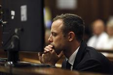 Olympic and Paralympic track star Oscar Pistorius reacts in the dock on the third day of his trial for the murder of his girlfriend Reeva Steenkamp at the North Gauteng High Court in Pretoria, March 5, 2014. REUTERS/Alon Skuy/Pool