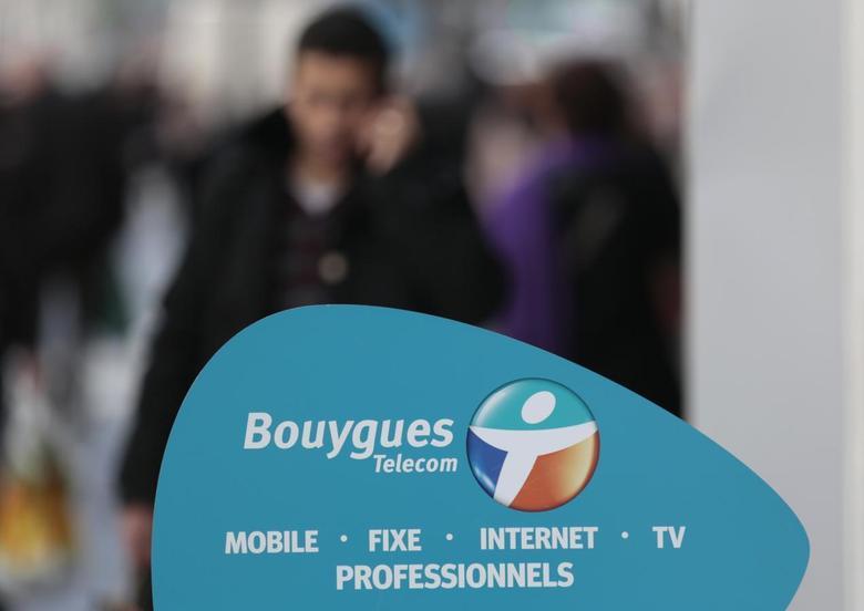 A man makes a phone call near a Bouygues Telecom company shop in Nice March 5, 2014. REUTERS/Eric Gaillard