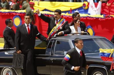 Venezuela's Chavez remembered with pomp and protests