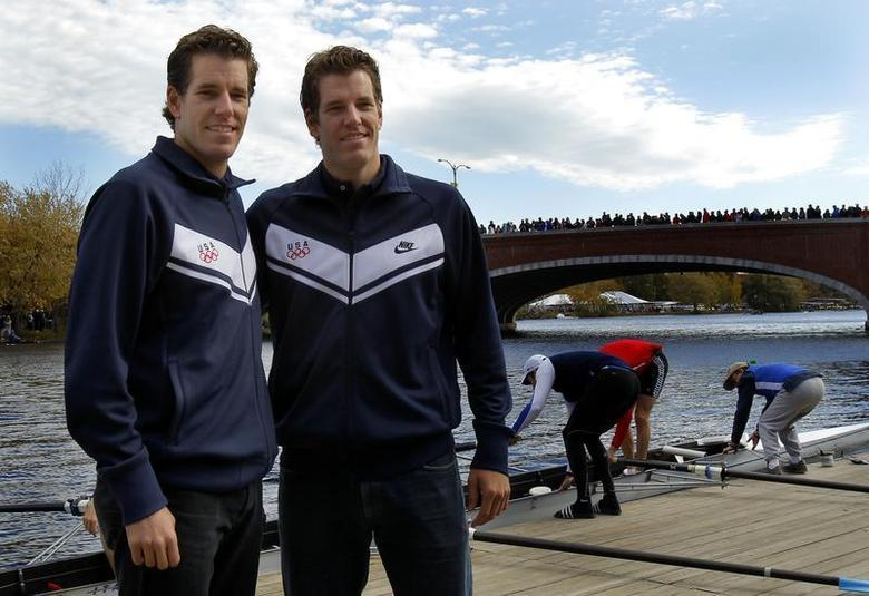Cameron (L) and Tyler Winklevoss pose at the Head of the Charles Regatta in Boston, Massachusetts October 23, 2010. REUTERS/Adam Hunger