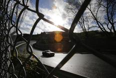 "A hobbyist racing driver steers his car towards the ""Bergwerk"" section of the legendary 13-mile (21-km) Nuerburgring race track, in the western German low mountain range of the Eifel near Adenau, October 27, 2013. REUTERS/Wolfgang Rattay"