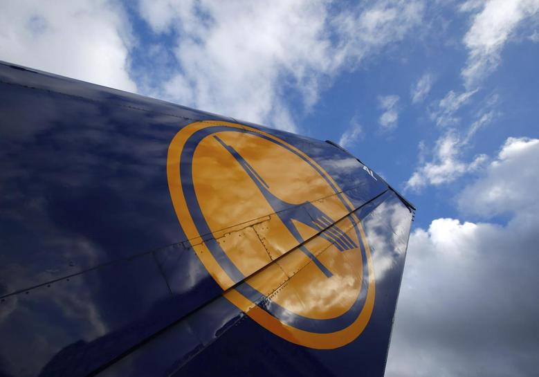 The tail of a decommissioned Lufthansa aircraft is pictured at Frankfurt airport February 11, 2014. REUTERS/Ralph Orlowski