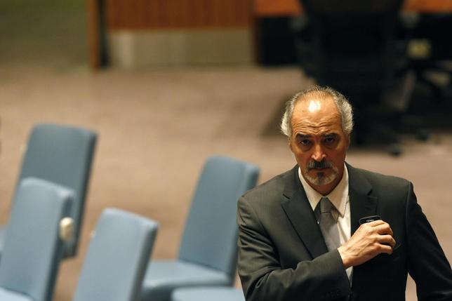 Syria's U.N. Ambassador Bashar Ja'afari walks through the hall during the U.N. Security Council meeting on Syria at the 68th United Nations General Assembly in New York September 27, 2013. REUTERS/Keith Bedford