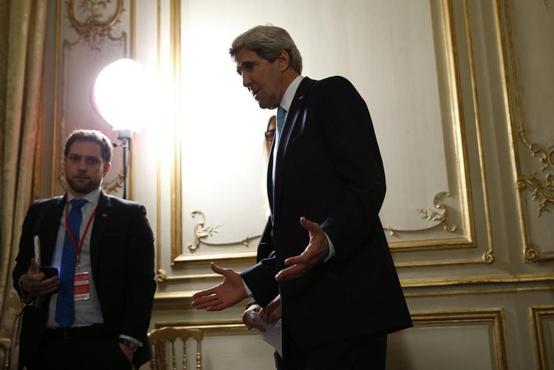 U.S. Secretary of State John Kerry answers questions about the Ukraine crisis after his meetings with other foreign ministers in Paris, March 5, 2014. REUTERS/Kevin Lamarque