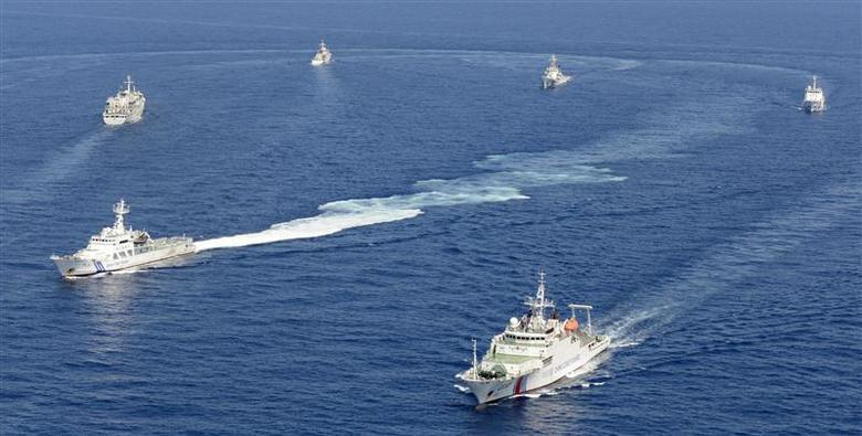 Vessels from the China Maritime Surveillance and the Japan Coast Guard are seen near disputed islands, called Senkaku in Japan and Diaoyu in China, in the East China Sea, in this photo taken by Kyodo September 10, 2013. REUTERS/Kyodo