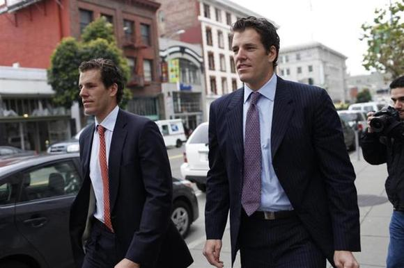 Cameron Winklevoss (L) and brother Tyler Winklevoss leave the 9th Circuit Court of Appeals after a hearing on a settlement dispute with Facebook's Mark Zuckerberg in San Francisco, California January 11, 2011. REUTERS/Stephen Lam/Files