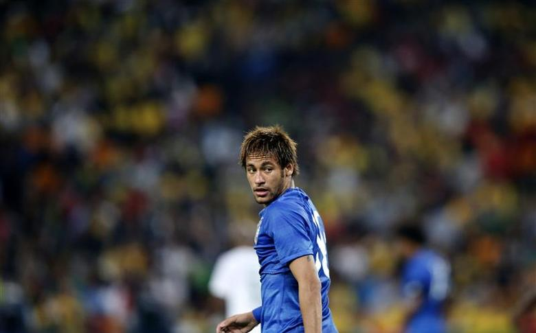 Brazil's Neymar looks on during their international friendly soccer match against South Africa at the First National Bank (FNB) Stadium, also known as Soccer City, Johannesburg March 5 2014. REUTERS/Siphiwe Sibeko