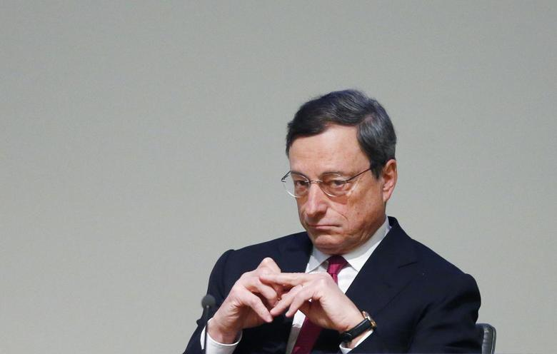 European Central Bank (ECB) President Mario Draghi waits to deliver a speech at a conference for the 20th anniversary of the establishment of the European Monetary Institute, in Brussels February 12, 2014. REUTERS/Francois Lenoir
