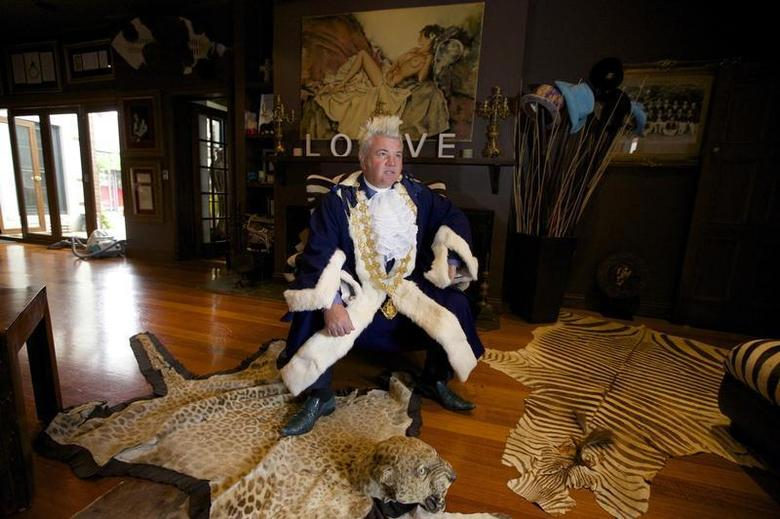 Newly elected Geelong Mayor, Darryn Lyons poses for a photograph in his mayoral robes in the living room of his home in Geelong February 27, 2014. REUTERS/Jason Reed
