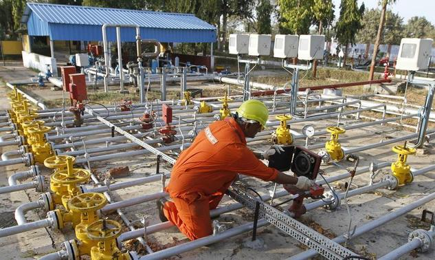 A technician works inside the Oil and Natural Gas Corp (ONGC) group gathering station on the outskirts of Ahmedabad March 2, 2012. REUTERS/Amit Dave/Files