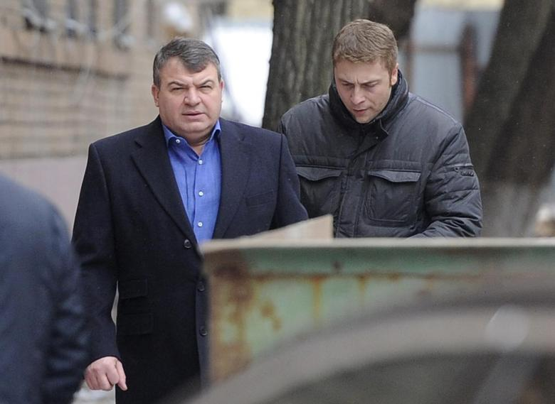 Former Russian Defence Minister Anatoly Serdyukov (L) arrives by a back entrance for questioning by investigators in Moscow December 3, 2013 file photo. REUTERS/Anton Tarasov