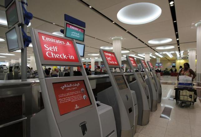 Self check-in kiosks are seen at the Emirates Airlines departures terminal at Dubai International Airport, February 6, 2012. REUTERS/Jumana El Heloueh