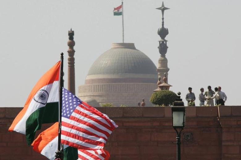 Indian and U.S. national flags flutter in front of the Presidential Palace in New Delhi February 28, 2006. REUTERS/B Mathur/Files