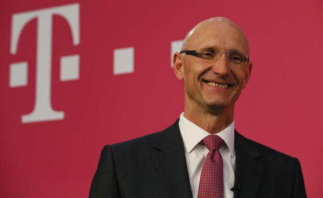 Timotheus Hoettges, CEO of Germany's telecommunications giant Deutsche Telekom AG poses in front of the company's logo following the annual news conference in Bonn March 6, 2014. REUTERS/Wolfgang Rattay