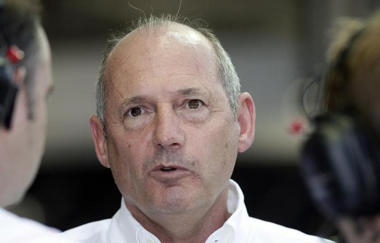 Chairman of McLaren Ron Dennis speaks before a practice session for the Singapore F1 Grand Prix September 27, 2008. REUTERS/Bazuki Muhammad