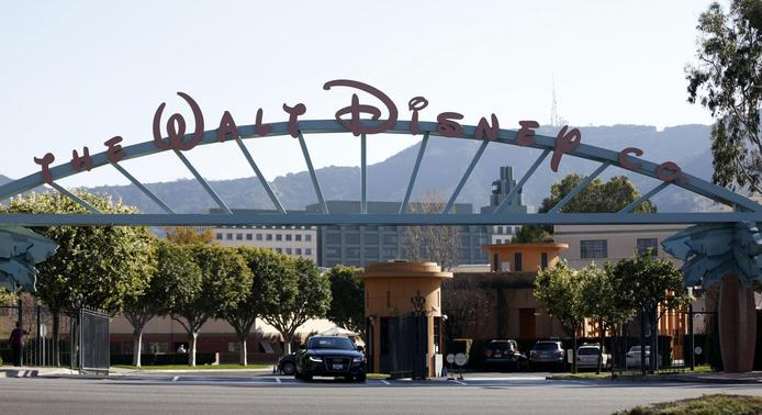 The entrance gate to The Walt Disney Co is pictured in Burbank, California February 5, 2014. REUTERS-Mario Anzuoni