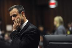 Olympic and Paralympic track star Oscar Pistorius reacts during the fourth day of his trial for the murder of his girlfriend Reeva Steenkamp at the North Gauteng High Court in Pretoria, March 6, 2014. REUTERS/Werner Beukes/Pool