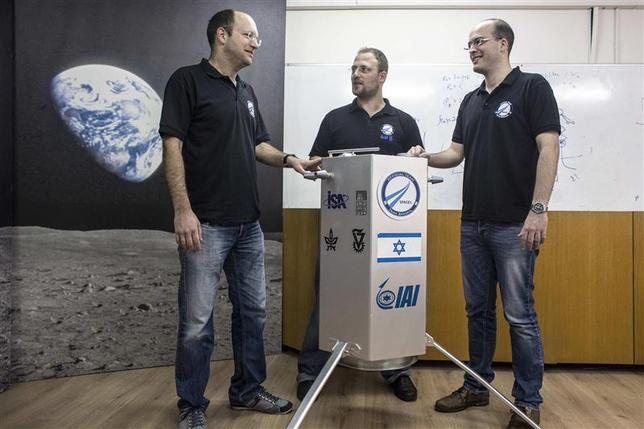 The co-founders of SpaceIL Yariv Bash (L), Kfir Damari (C) and Yonatan Winetraub stand next to their company's spacecraft process prototype at Bar-Ilan University, near Tel Aviv February 24, 2014. REUTERS/Nir Elias