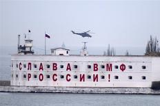 An attack helicopter, believed to Russian, flies over a Russian military base in at Crimean port of Sevastopol March 6, 2014. REUTERS/Baz Ratner