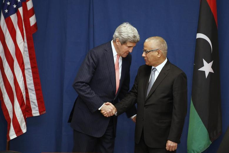 U.S. Secretary of State John Kerry shakes hands with Libyan Prime Minister Ali Zeidan at the Conference on International Support to Libya in Rome March 6, 2014. REUTERS/Kevin Lamarque