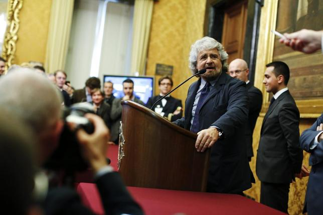 Leader of ''5-Star'' movement and comedian Beppe Grillo talks to reporters at the end of the consultations with Italian Prime Minister-designate Matteo Renzi (not pictured) at the Parliament in Rome February 19, 2014. REUTERS/Tony Gentile