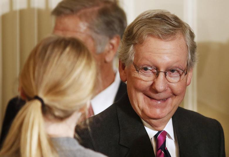 U.S.Sen. Mitch McConnell (R-KY) walks out after President Barack Obama announced the first five ''Promise Zones'' as promised in last year's State of the Union Address as a way to create jobs in the East Room of the White House in Washington, January 9, 2014. REUTERS/Larry Downing