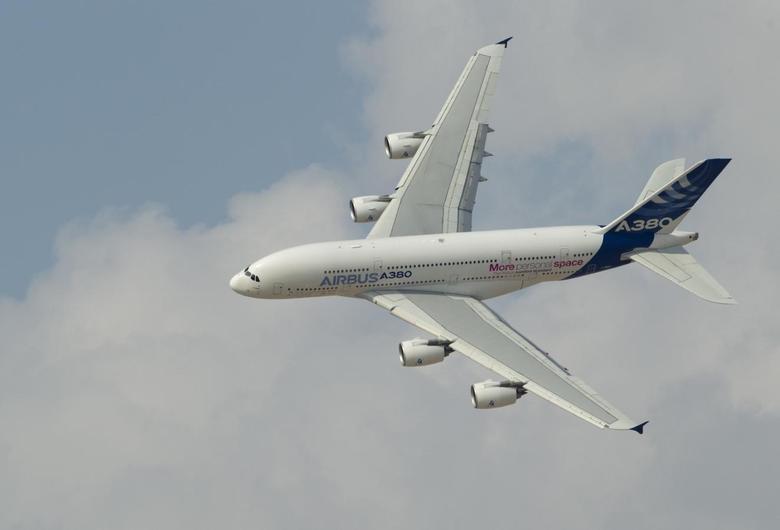 An Airbus A380, the world's largest passenger jet, flies during the Dubai Airshow November 18, 2013. REUTERS/Caren Firouz