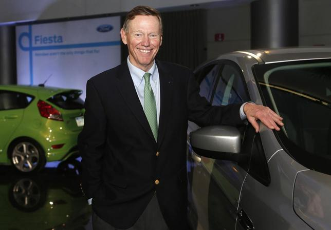 Ford Motor Co. CEO Alan Mulally poses next to a Ford vehicle during a gathering with members of the media at the Ford Conference Center in Dearborn, Michigan December 12, 2013. REUTERS/Rebecca Cook