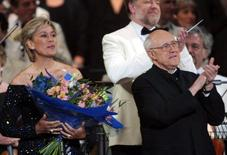 "Dame Kiri Te Kanawa, (L) and Mstislav Rostropovich on stage at the end of the ""Prom At The Palace"" concert in the grounds of London's Buckingham Palace as part of Britain's Queen Elizabeth II Golden Jubilee celebrations June 1, 2002. REUTERS/Alastar Grant"