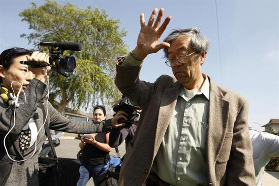 A man widely believed to be Bitcoin currency founder Satoshi Nakamoto is surrounded by reporters as he leaves his home in Temple City, California March 6, 2014. REUTERS/David McNew