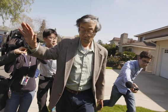 Satoshi Nakamoto is surrounded by reporters as he leaves his home in Temple City, California, March 6, 2014. REUTERS-David McNew