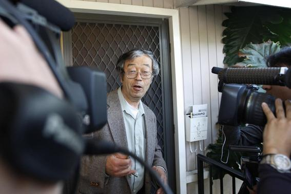 A man widely believed to be Bitcoin currency founder Satoshi Nakamoto is surrounded by reporters as he leaves his home in Temple City, California March 6, 2014. REUTERS-David McNew