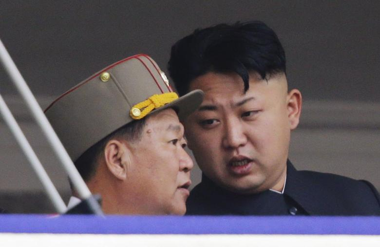 North Korean leader Kim Jong-un speaks to Choe Ryong-hae (L)during a parade to commemorate the 60th anniversary of the signing of a truce in the 1950-1953 Korean War, at Kim Il-sung Square in Pyongyang July 27, 2013 file photo. REUTERS/Jason Lee