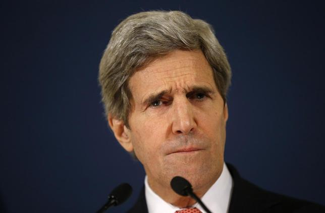 U.S.Secretary of State John Kerry listens to a question from a reporter during a news conference at the U.S. Embassy in Rome March 6, 2014. REUTERS/Kevin Lamarque